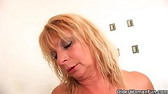 Heavy breasted granny gives her pussy a delicious in the shower