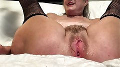 Horny Wife Spreads Her Pussy And Masturbates Surrounding Her Favorite Toy