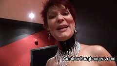 Mature redhead takes two together in her pussy